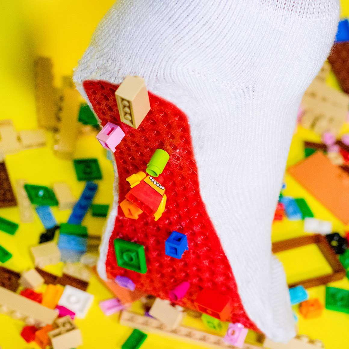 op Lego staan